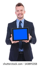 young business man giving a tablet with a blank blue screen while smiling. on white background