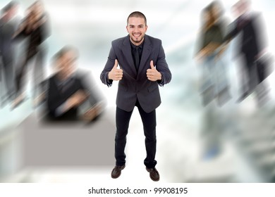 young business man going thumbs up
