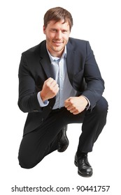 Young business man happy about achievement isolated on white background