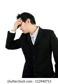 Young business man with headache on white background