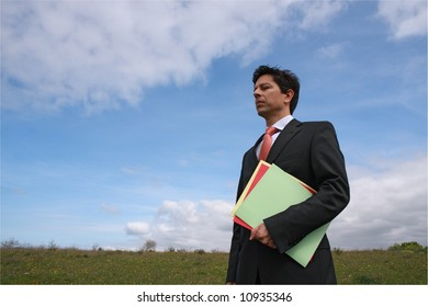 Young business man holding three colorful dossier ready to working