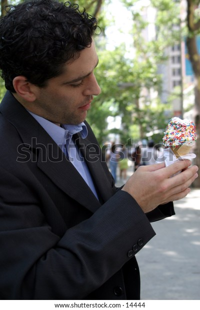 young business man with ice cream cone