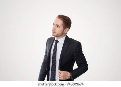 Young business man Keeping an eye out with suit in the studio