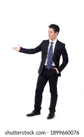 A young Business man laughing with fists up high quality photo