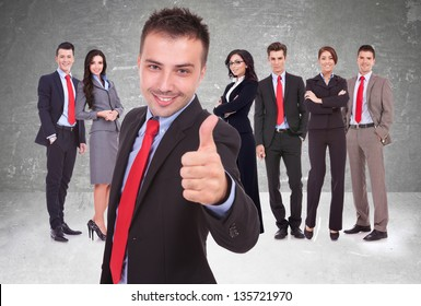 young business man leader of a successful team making the thumbs up ok gesture