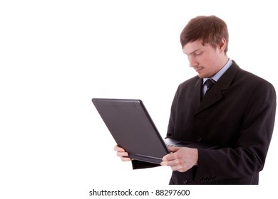 The young business man is looking at the display of his laptop