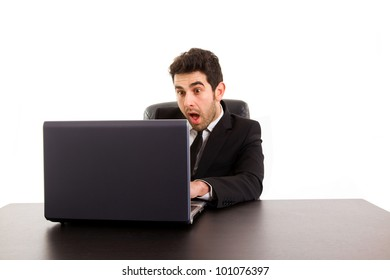 Young business man looking at screen computer with a excited expression, isolated on white