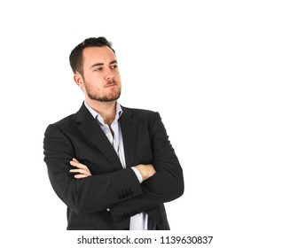 Young business man looking serious against a white background