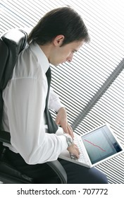 young business man in office with laptop
