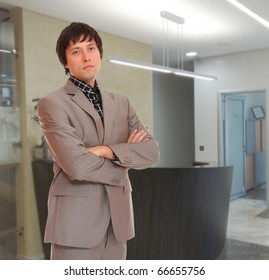 Young business man in the office workplace.