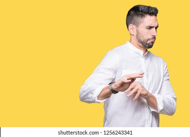 Young business man over isolated background disgusted expression, displeased and fearful doing disgust face because aversion reaction. With hands raised. Annoying concept.