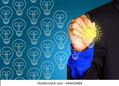 Young business man point to yello virtual bulb symbol - leadership and task distribution management