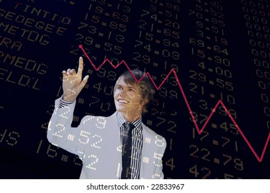 young business man pointing to a chart isolated on black