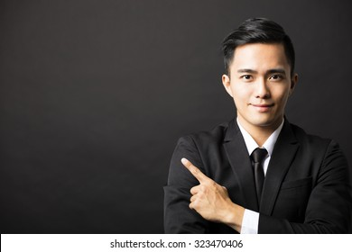 young  business man with pointing gesture