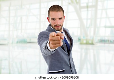 young business man pointing at the office