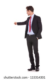 young business man pointing at something at his back on white background