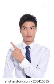 Young business man pointing at something interesting on a white background