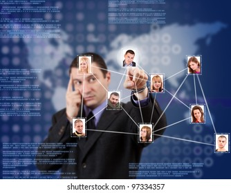 Young business man pressing Social network pictures in digital futuristic blue background