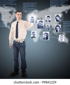 Young business man pressing Social network pictures in digital futuristic background