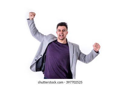 young business man with raised arms yelling celebrating success
