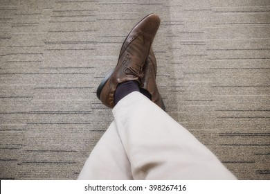 young business man relaxing chilling with legs crossed on carpet floor in the office