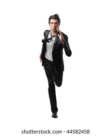 young business man running isolated on white background