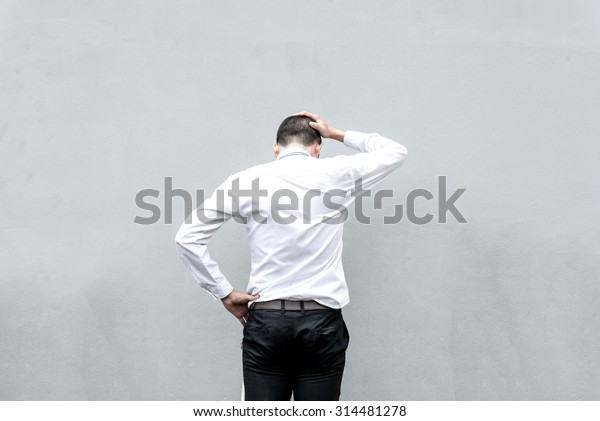 Young business man serious thinking with hand on head
