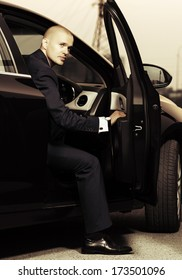 Young business man sitting in the car