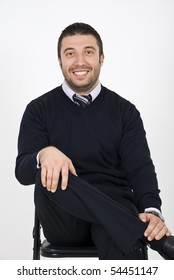 Young business man sitting in chair and smiling for you