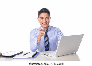 Young business man sitting working with laptop