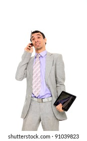 young business man standing using a tablet and talking on the phone isolated on white background