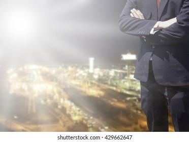 Young business man success or soft Business man success in he work on marketing online business or internet with global learning on over blurred top business city view with light flare from corner.