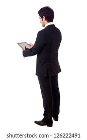 Young business man with tablet computer. Isolated over white background.