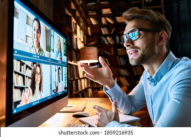 Young business man talking with diverse colleagues in virtual video conference group chat using computer at home office. Online professional videoconference communication, social distance work concept