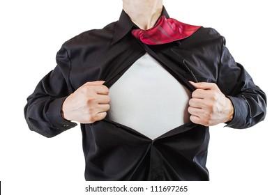 Young business man tearing apart his shirt revealing a superhero suit