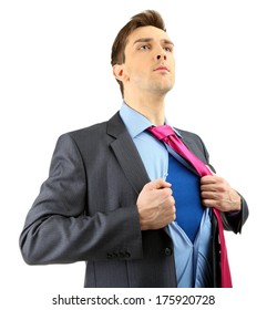 Young business man tearing apart his shirt revealing  superhero suit, isolated on white