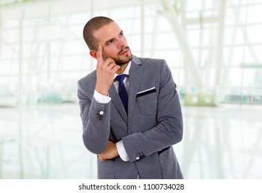 young business man thinking at the office