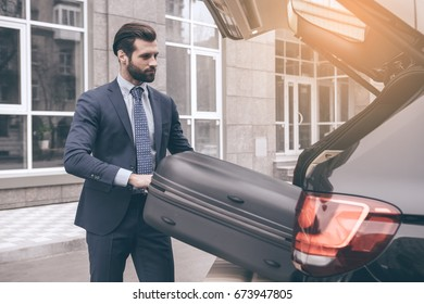 Young business man travel by car alone