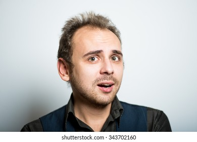 young business man upset manager office concept, shot isolated on gray background