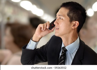 Young business man use cellphone in train.