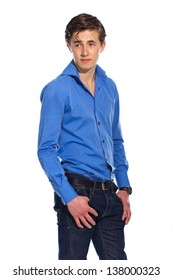 Young business man wearing blue shirt and jeans. Isolated on white.