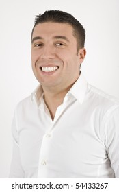 Young business man in a white shirt with a big smile