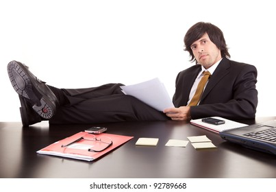Young business man at work, isolated over white