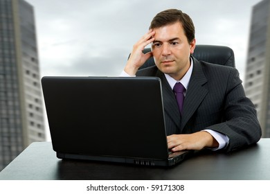 young business man working with is laptop at the office