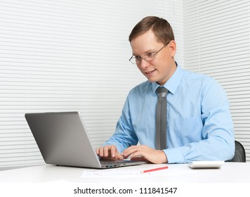 young business man working on computer at office desk