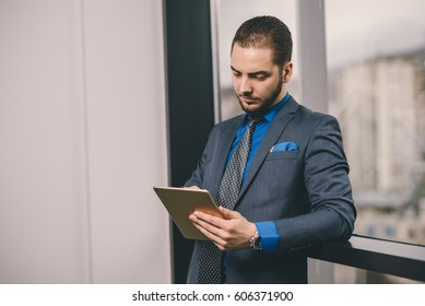 Young business man working on tablet