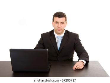 Young business man working on a laptop computer, isolated