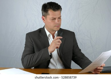 Young business man writing on a paper