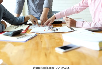young business managers crew working with new startup project.Notebook paper work on wood table, Team meeting concept