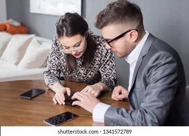 Young business married couple sitting at table